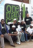 Sonke Staff in front of OMC mural