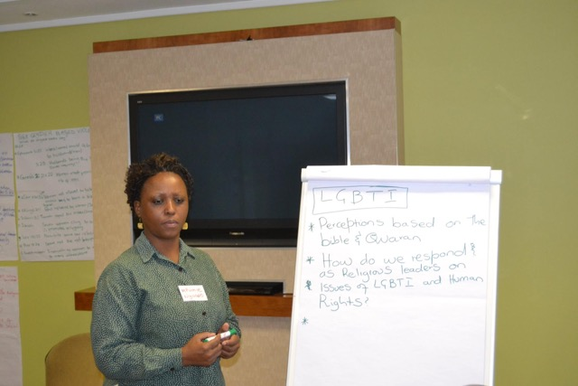 From Swaziland - workshop participant, Nompumelelo Nyawo, listens attentively to a question while giving a report on her group's breakaway session.