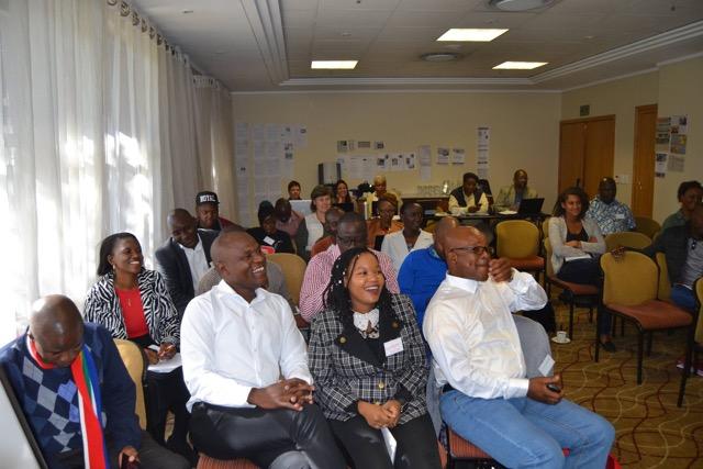 Workshop participants enjoy a light moment during a presentation.