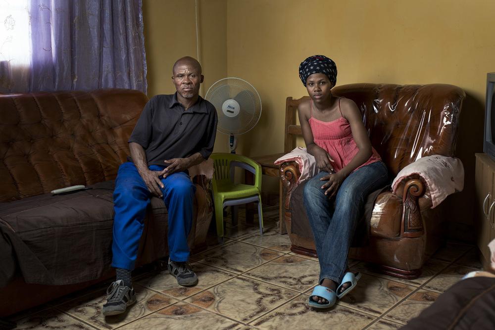 Bangumzi Balakazi at home with his daughter Zintathu