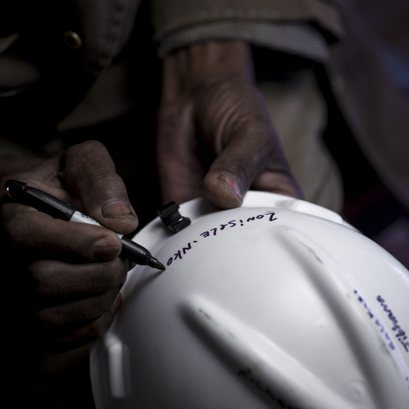 Zonisele signs the miners helmet, leaving space for all the rest